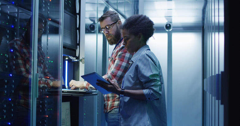 Diverse IT colleagues setting server hardware