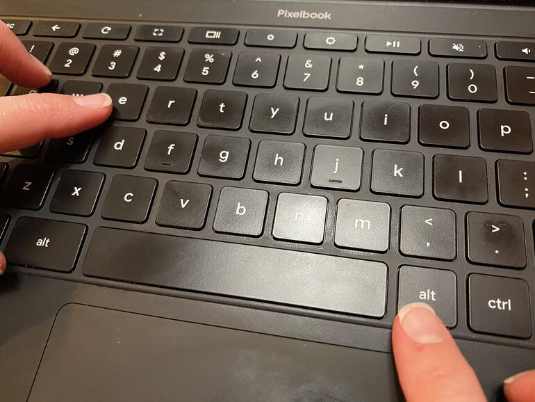 Photo with fingers on ALT key to the right of the space bar and another key about to press the e key.