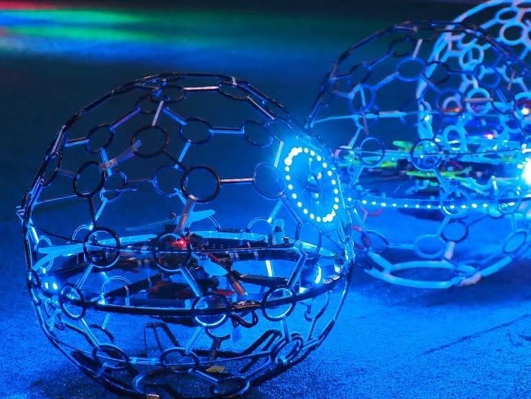 Drones with exoskeletons face off in soccer challenge